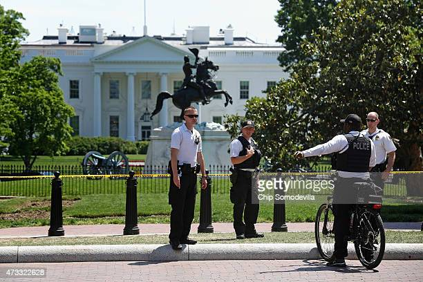 Members of US Secret Service Uniform Division keep people out of Lafayette Park as investigators collect evidence across the street from the White...