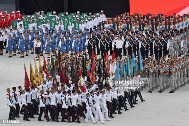 Members of various branches of the armed forces march in during the 52nd Singapore National Day parade and celebration in Singapore on August 9 2017...