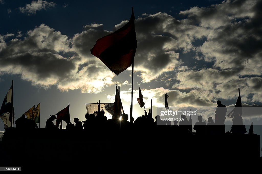 Members of various labour unions take part in a demonstration in front National Congress in Brasilia, Brazil, on July 11, 2013 during a day of strikes and demonstrations called by the country's five leading labor federations to demand better public services and an end to endemic corruption.. AFP PHOTO/Evaristo Sa