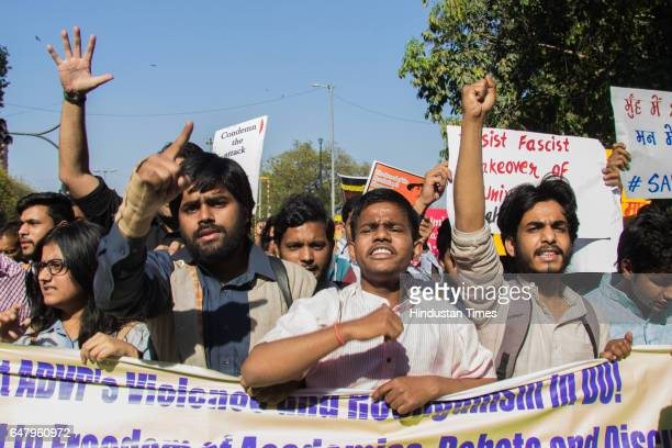 Members of various Left wing student organizations shout slogans their protest march against RSS and ABVP over their alleged attack in Ramjas college...
