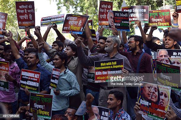 Members of various Muslim groups display placards during a protest against Dadri lynching incident at Jantar Mantar in New Delhi