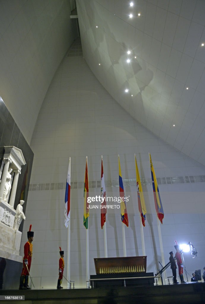 Members of Venezuelan Honor Guard stand by the coffin of South American independence hero Simon Bolivar during a ceremony of the new mausoleum, in Caracas on May 14, 2013. The President of Venezuela, Nicolás Maduro, opened Tuesday in Caracas the mausoleum that will house the remains of the Liberator Simón Bolívar, an imposing monument created in 2010 by the deceased Hugo Chávez. AFP PHOTO