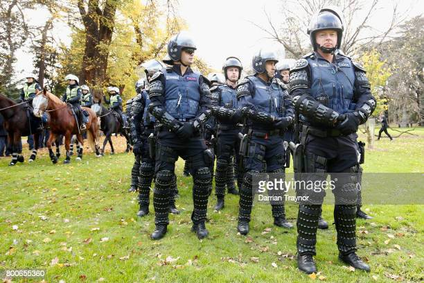 Members of Victoria Police Public Order Response team keep watch on June 25 2017 in Melbourne Australia An anti racist rally was organised to counter...