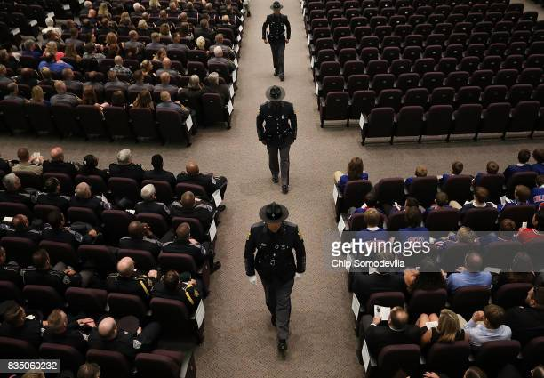 Members of Virginia State Police prepare for the funeral of fellow TrooperPilot Berke MM Bates at Saint Paul's Baptist Church August 18 2017 in...