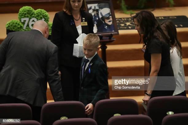 Members of Virginia State Police TrooperPilot Berke MM Bates arrive for his funeral at Saint Paul's Baptist Church August 18 2017 in Richmond...