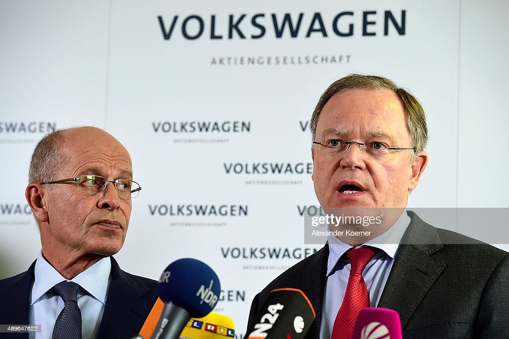 Members of Volkswagen's Supervisory board Berthold Huber (L) and Stephan Weil inform waiting journalists about the decision of Martin Winterkorn to resign during a press conference at Volkswagen production plant on September 23, 2015 in Wolfsburg, Germany. Volkswagen CEO Martin Winterkorn and other members of the supervisior board are believed to meet inside the headquarters to discuss the Volkswagen Diesel emission scandal, which affects 11 million vehicles worldwide.