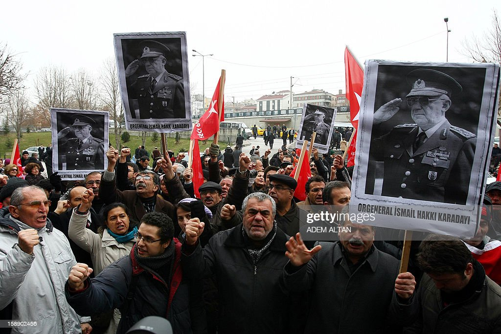 Members of Workers' Party demonstrate in favor of former Turkish Chief of Staff Ismail Hakki Karadayi as he arrives at a courthouse in Ankara on January 3, 2013. A prosecutor began questioning Karadayi for his role in the ousting of an Islamic-led coalition government in 1997. Authorities in Turkey have detained a former military chief for his alleged role in a 1997 coup that forced an Islamic-leaning government from power, Anatolia news agency reported on January 3. The retired general, Ismail Hakki Karadayi, is expected to testify before an Ankara court as part of an investigation that was launched in 2011 and has led to the arrests of dozens of military officers. AFP PHOTO / ADEM ALTAN