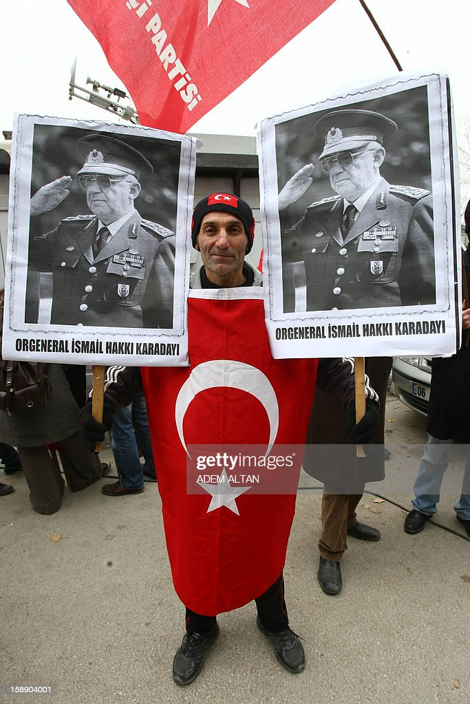 Members of Workers' Party demonstrate in favor of former Turkish Chief of Staff Ismail Hakki Karadayi as he arrives at a courthouse in Ankara on January 3, 2013. A prosecutor began questioning Karadayi for his role in the ousting of an Islamic-led coalition government in 1997. Authorities in Turkey have detained a former military chief for his alleged role in a 1997 coup that forced an Islamic-leaning government from power, Anatolia news agency reported on January 3. The retired general, Ismail Hakki Karadayi, is expected to testify before an Ankara court as part of an investigation that was launched in 2011 and has led to the arrests of dozens of military officers.