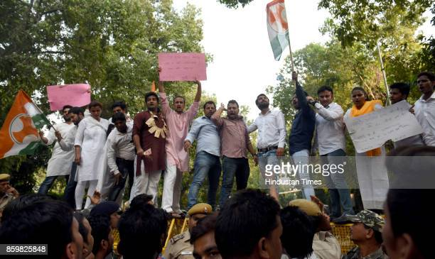Members of Youth Congress protest against Amit Shah's son at BJP headquarters at Ashoka Road on October 10 2017 in New Delhi India Sensing an...
