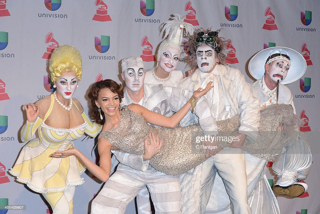 Members of Zarkana Cirque du Soleil and Singer <a gi-track='captionPersonalityLinkClicked' href=/galleries/search?phrase=Leslie+Grace&family=editorial&specificpeople=9567772 ng-click='$event.stopPropagation()'>Leslie Grace</a> arrives at the 14th Annual Latin GRAMMY Awards at Mandalay Bay Events Center on November 21, 2013 in Las Vegas, Nevada.