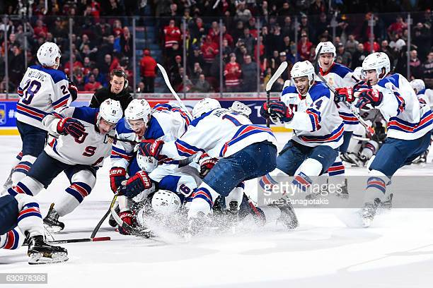 Members or Team United States celebrate their shootout victory during the 2017 IIHF World Junior Championship semifinal game against Team Russia at...