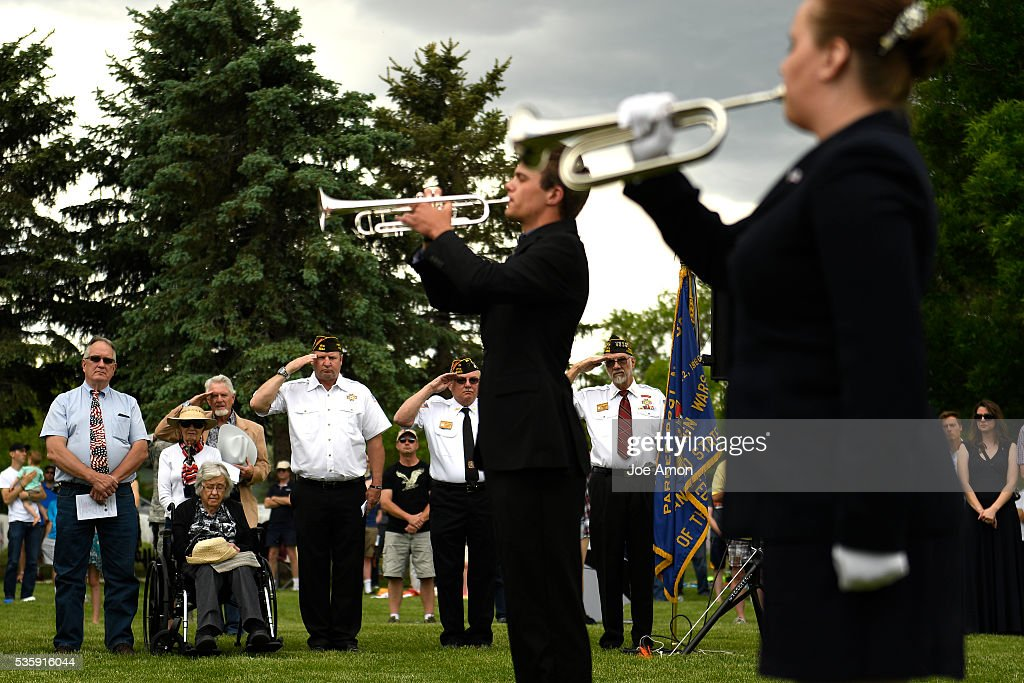 VFW members Paul Gremse, Floyd Merenkov and Gerard Brushaber salute during the playing of Taps at the Memorial Day ceremony, 84th Anniversary of Remembrance at Fort Logan National Cemetery. May 30, 2016 in Denver, CO.