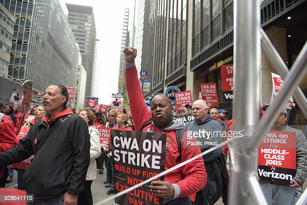 CWA members raise fists chant at rally in defiance of Verizon Hundreds of striking CWA workers marched across Lower Manhattan to rally in front of...
