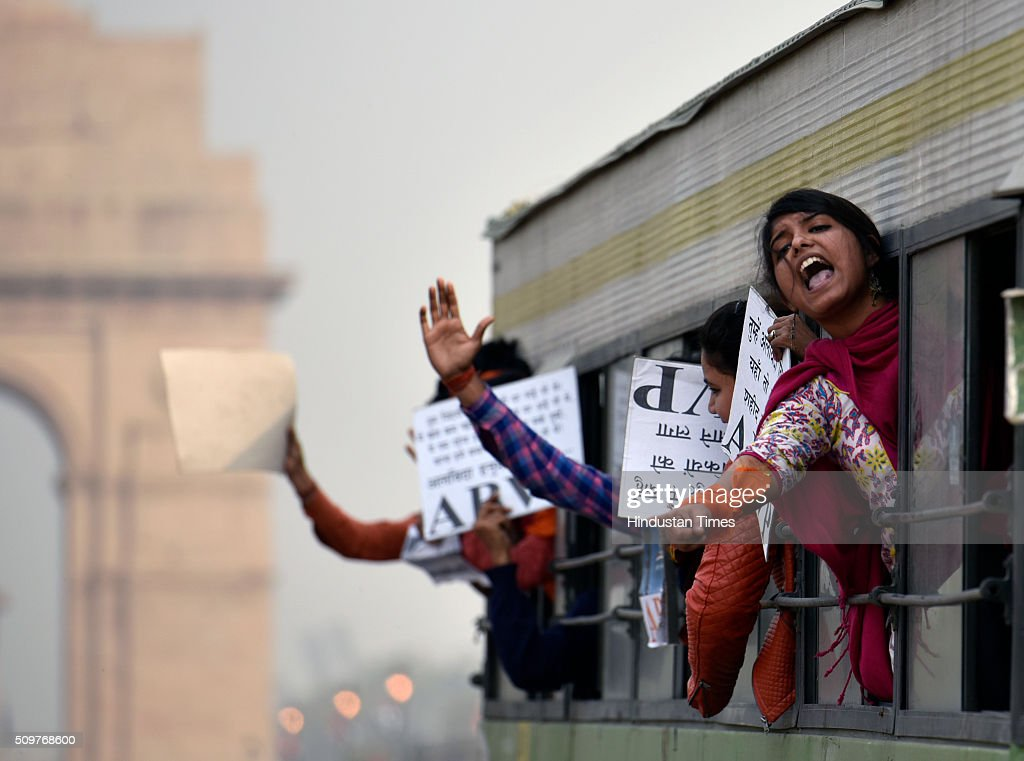 ABVP members shout slogans as they are detained by police during their protest march against the anti-national activities in JNU on February 12, 2016 in New Delhi, India. JNU students union president Kanhaiya Kumar was arrested on in connection with a case of sedition and criminal conspiracy over holding of an event at the prestigious institute against hanging of Parliament attack convict Afzal Guru in 2013. A group of students on Tuesday held an event on the JNU campus and allegedly shouted slogans against India.