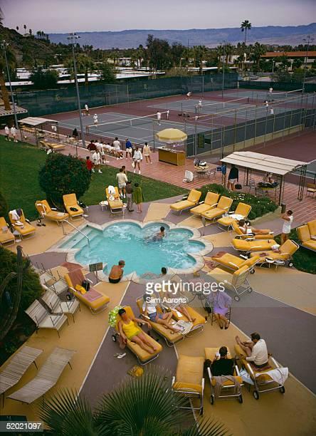 Members sunbathe around the pool at Palm Springs Tennis Club California circa 1970