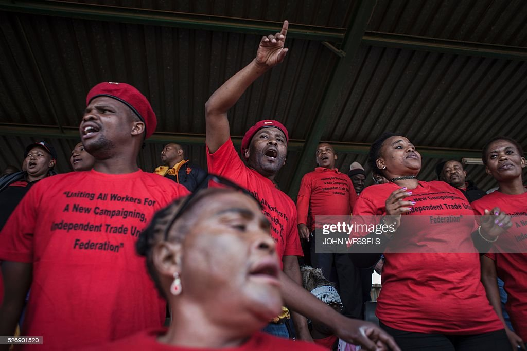 Members, supporters and non-unionized workers of National Union of Metalworkers of South Africa (NUMSA), one of the biggest South African unions that was expelled from the main South African Trade Unions Federation (COSATU), cheer during a May Day rally organized by a new United Front South African labour movement at Tembisa stadium on May 1, 2016 in Tembisa, South Africa. / AFP / JOHN