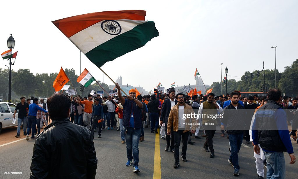 ABVP members take out protest march against the anti-national activities in JNU on February 12, 2016 in New Delhi, India. JNU students union president Kanhaiya Kumar was arrested on in connection with a case of sedition and criminal conspiracy over holding of an event at the prestigious institute against hanging of Parliament attack convict Afzal Guru in 2013. A group of students on Tuesday held an event on the JNU campus and allegedly shouted slogans against India.