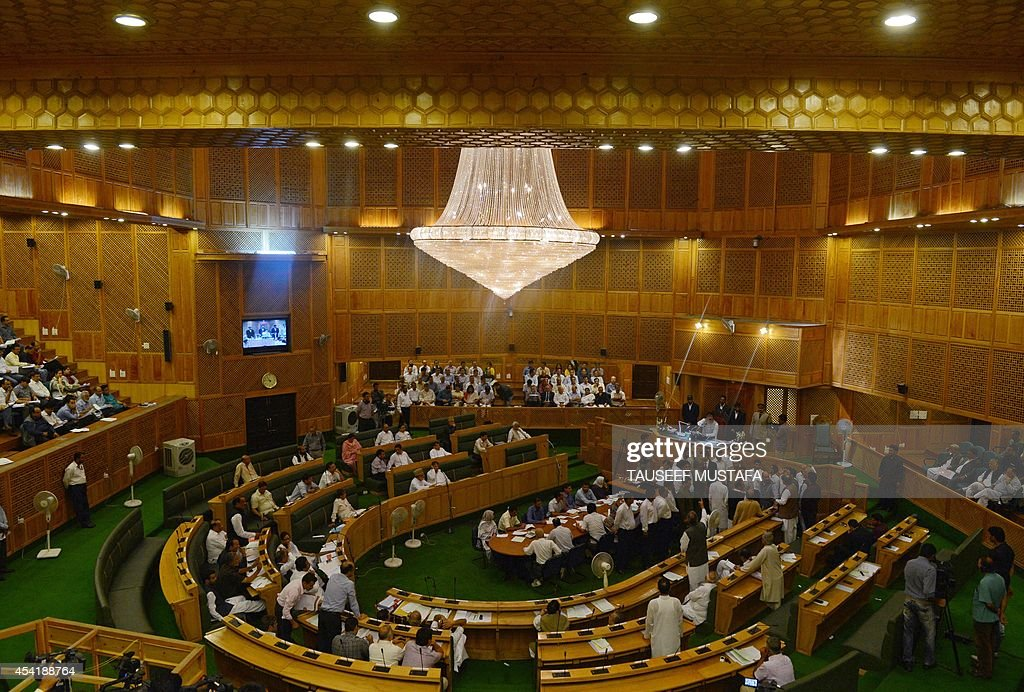 Members take part in a session of the state legislative assembly in the town of Srinagar in Indian-administered Kashmir on August 26, 2014. The Peoples Democratic Party (PDP) has demanded a discussion regarding criminal cases registered against some 6,000 youths in the Kashmir Valley, accused to stone-throwing, arguing those with cases registered against them are unable to seek government jobs or apply for passports. AFP PHOTO/Tauseef MUSTAFA