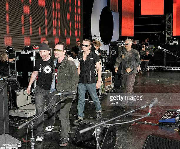 U2 members The Edge Bono Larry Mullen Jr and Adam CLayton exit the stage at 'Live 8 London' in Hyde Park on July 2 2005 in London England The free...