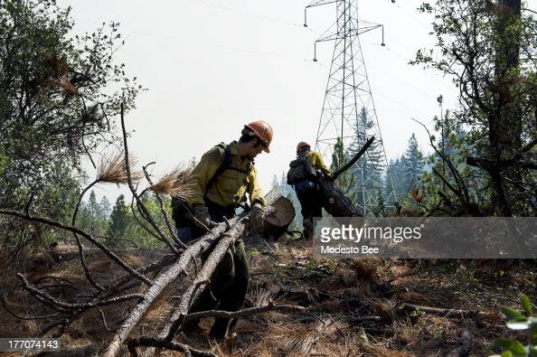 Members to the Horseshoe Meadow Hotshots Chuck Ervin left and Ian White prepare a fire break at the Rim Fire in the Stanislaus National Forest in...