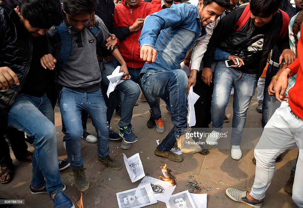 ABVP members tramp the images of terrorists Afzal Guru, Maqbool Bhatt and Azmal Kasab during their protest against the anti-national activities in JNU on February 12, 2016 in New Delhi, India. JNU students union president Kanhaiya Kumar was arrested on in connection with a case of sedition and criminal conspiracy over holding of an event at the prestigious institute against hanging of Parliament attack convict Afzal Guru in 2013. A group of students on Tuesday held an event on the JNU campus and allegedly shouted slogans against India.