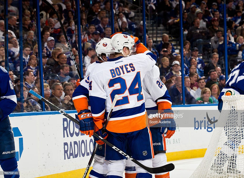 Memberts of the New York Islanders celebrate after a second-period goal by <a gi-track='captionPersonalityLinkClicked' href=/galleries/search?phrase=John+Tavares&family=editorial&specificpeople=601791 ng-click='$event.stopPropagation()'>John Tavares</a> #91 of the New York Islanders against the Tampa Bay Lightning at the Tampa Bay Times Forum on March 14, 2013 in Tampa, Florida.