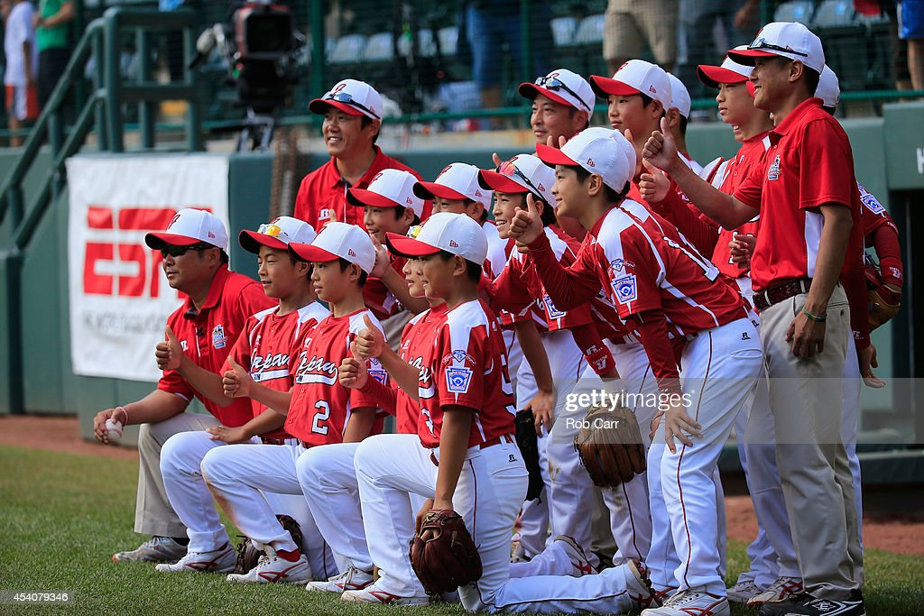 Membes of Team Japan pose for a photo after defeating the West Team from Las Vegas, Nevada during the Little League World Series third place game at Lamade Stadium on August 24, 2014 in South Williamsport, Pennsylvania.