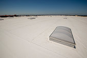 PVC roof with skylights on a very large warehouse building.