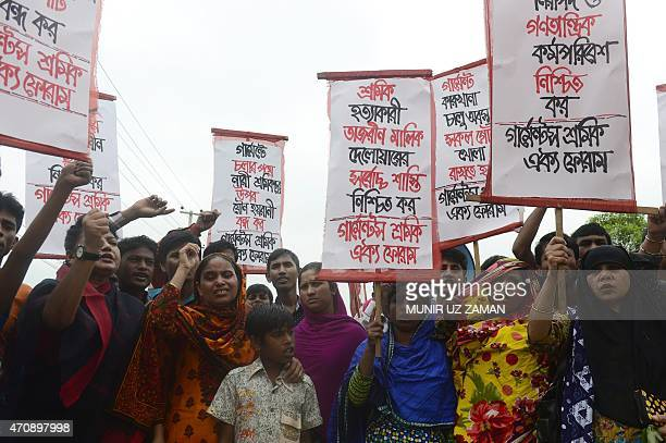 Memebers of Bangladeshi garments worker union shout slogans as they mark the second anniversary of the Rana Plaza building collapse at the site where...
