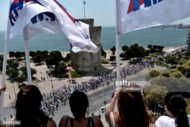 Memebers of the AllWorkers Militant Front a Greek trade union movement founded on the initiative of the Greek Communist Party march during a...