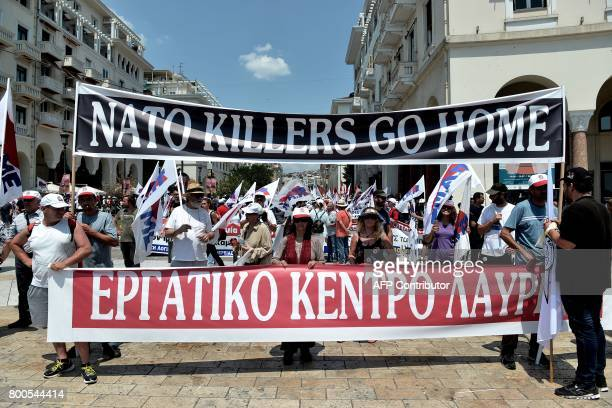 Memebers of the AllWorkers Militant Front a Greek trade union movement founded on the initiative of the Greek Communist Party carry banners during a...