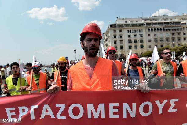 Memebers of the AllWorkers Militant Front a Greek trade union movement founded on the initiative of the Greek Communist Party carry banners and chant...