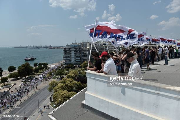 Memebers of the AllWorkers Militant Front a Greek trade union movement founded on the initiative of the Greek Communist Party wave flags during a...