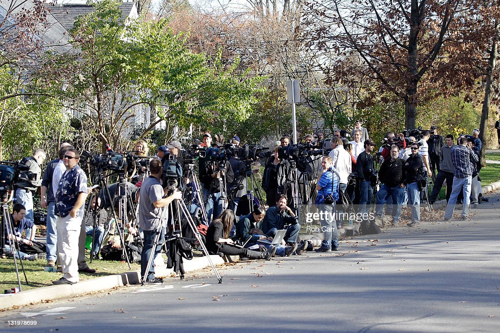 Memebers of the media stand outside the home of Penn State University head football coach Joe Paterno on November 9, 2011 in State College, Pennsylvania.