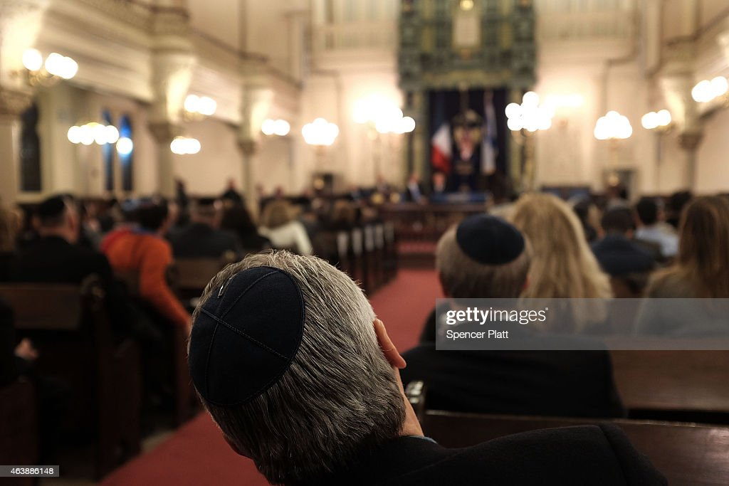 Memebers of the New York Jewish Community listen as France's chief rabbi Haim Korsia discusses antisemitism and terrorism at the Park East Synagogue...