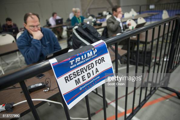 Memebers of the news media file stories and pictures from the press pen following a rally with Republican presidential candidate Donald Trump at...