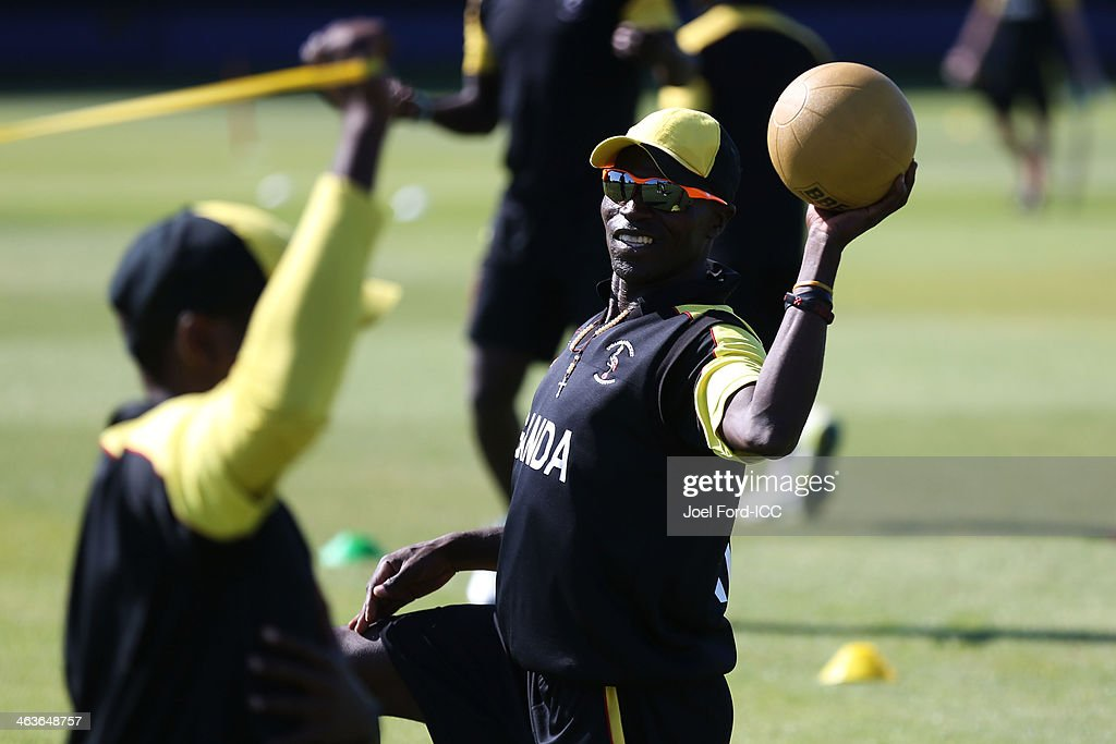 Memebers of the Uganda cricket team warm-up prior to an ICC World Cup qualifying match against Uganda on January 19, 2014 in Mount Maunganui, New Zealand.