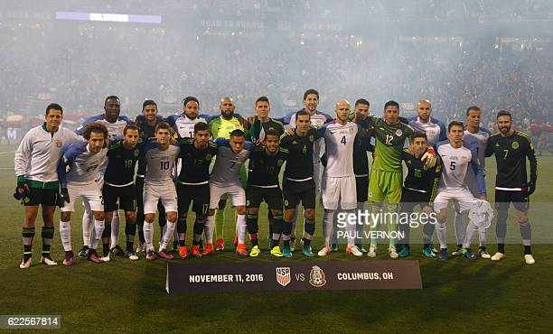 Memebers of the US men's national team and Mexico men's national team pose for a group photo before the start of a 2018 FIFA World Cup qualifying...