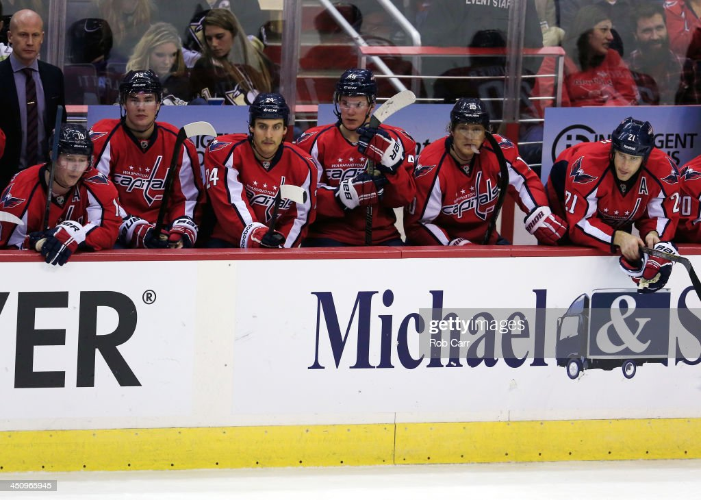Memebers of the Washington Capitals look on from the bench during the second period of their 4-0 loss to the Pittsburgh Penguins at Verizon Center on November 20, 2013 in Washington, DC.