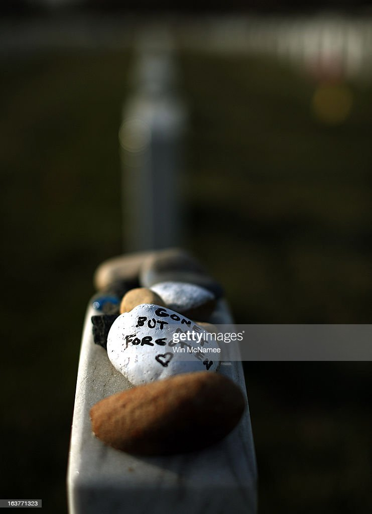 Mementos are left on top of the headstone of U.S. Army Master Sergeant Joseph J. Andres, Jr of Seven Hills, Ohio, in Section 60 at Arlington National Cemetery March 15, 2013 in Arlington, Virginia. Section 60 is the section of the cemetery where American military members killed in Iraq and Afghanistan are currently laid to rest, though soldiers and Marines from World War II through Afghanistan are also buried in the section. March 20th marks the ten-year anniversary of the beginning of the war in Iraq.