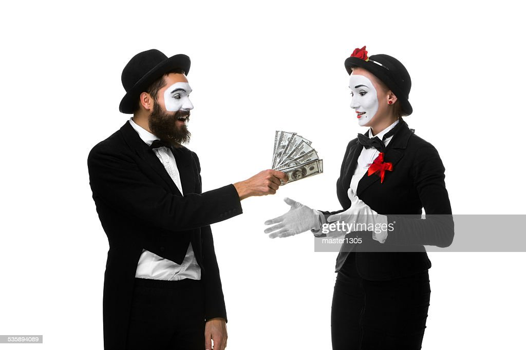 memes as businesswoman and businessman counting money : Stockfoto