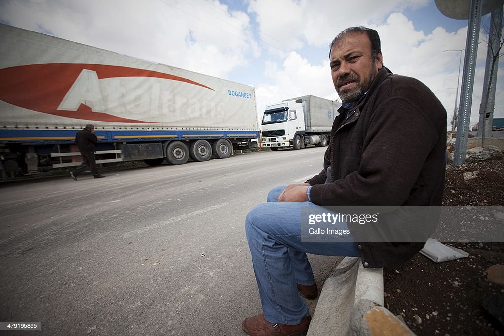 Memet Demircan on March 12, 2014, in Killis City, Turkey. The truck driver has been at the Kilis border now for 14 days, waiting to go through to the Syrian side. Truck drivers at the Turkish/ Syrian border near Kilis City wait 10-15 days to get their good through to the customs area where Syrian truckers can take the load to Syrian towns. Since ISIS moved out of the nearby Area of Azzaz more goods are collected by the Syrian trucks on the Bab Al Salame border.