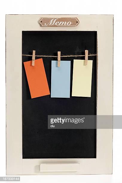 Memo board with three empty paper clips