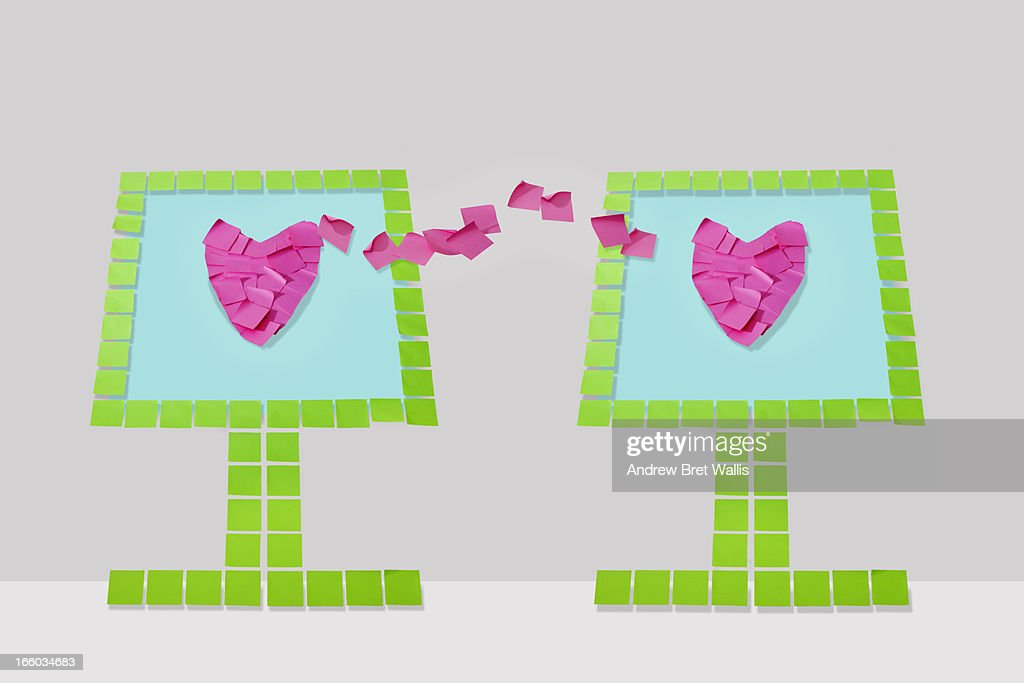 Memo note computers share screen heart shapes : Stock Photo