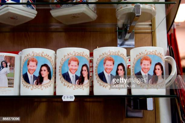 Memorabilia celebrating the engagement of Britain's Prince Harry to fiancée US actress Meghan Markle are pictured for sale in a gift shop in Windsor...