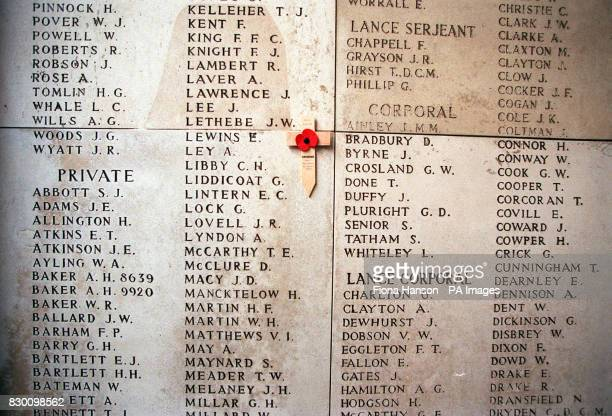 A memorial cross and poppy beside the name of Private E Lewins one of over 50000 British and Empire soldiers who died in the Ypres Salient during the...