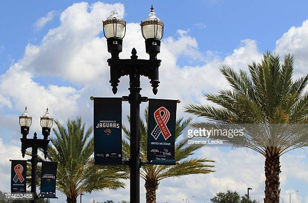 9/11 memorial flags hang from light poles ahead of the Tennessee Titans versus Jacksonville Jaguars season opener at EverBank Field on September 11...