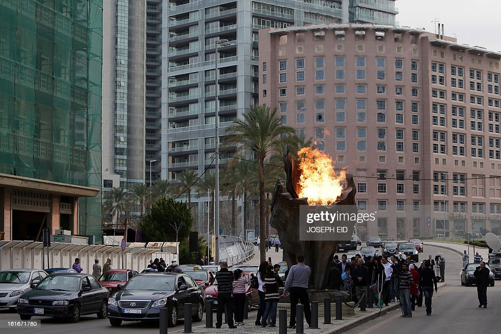 A memorial flame erected at the site of the assassination of former Lebanese prime minister Rafiq Hariri in Beirut is lit on February 14, 2013, to commemorate the eighth anniversary of his assassination in a massive car bomb attack that killed him along with 21 others while driving through the Lebanese capital. AFP PHOTO/JOSEPH EID