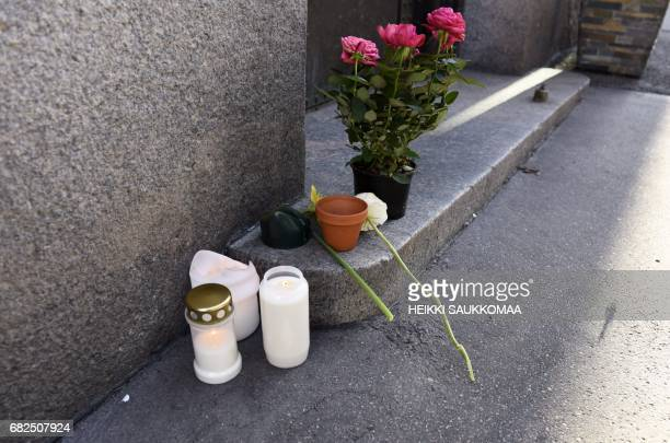 Memorial flowers and candles are pictured outside the home building of the former Finnish President Mauno Koivisto early on May 13 2017 in Helsinski...