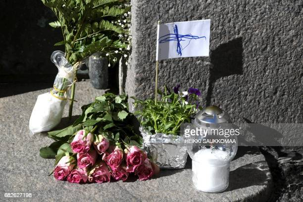 Memorial flowers and candles stand outside the home of former Finnish President Mauno Koivisto in Helsinki on May 13 2017 The former Finnish...